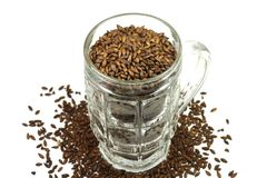 Caramel barley malt in a beer mug. On a white background Royalty Free Stock Photography