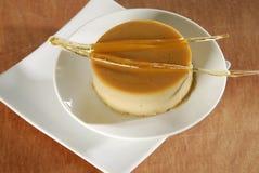 Caramel blancmange. Cream caramel with sweet sticks royalty free stock images