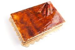 Caramel cake. Caramel orange cake with chocolate stuffed vanilla cream and nuts Royalty Free Stock Photos