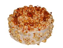 Caramel cake with caramel sauce and caramel popcorn royalty free stock photo