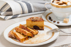 Caramel cake filled with chocolate and coffee with cream Stock Photos
