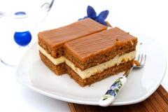 Caramel cake slice. Piece of sweet cake with caramel cream Royalty Free Stock Photo