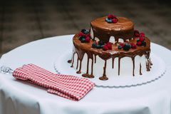 Caramel cake with strawberries, blackberries and blueberries royalty free stock image