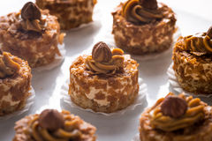 Caramel cakes with nuts Stock Images