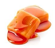 Caramel candies and sauce royalty free stock photos