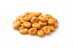 Caramel candies stack over white background Stock Image