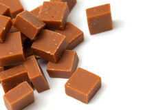 Caramel candies on white Stock Photography