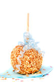 Caramel candy apple with peanuts Stock Photography