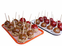 Caramel & candy apples. Caramel and candy apples on trays royalty free stock image