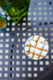Caramel cappuccino coffee glass on table in cafe Royalty Free Stock Image