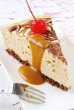 Caramel Cheesecake. With a cherry and caramel topping.  Delicious indulgence Royalty Free Stock Photo