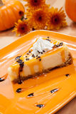 Caramel Cheesecake and Pumpkins Royalty Free Stock Photos
