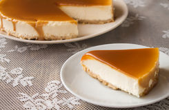 Caramel cheesecake. Salted caramel cheesecake on the table Royalty Free Stock Image