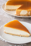 Caramel cheesecake. Salted caramel cheesecake on the table Stock Photos