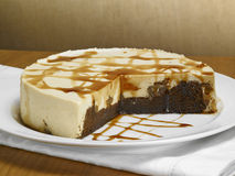 Caramel chocolate cake. On a wood background Royalty Free Stock Photography