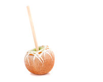 Caramel and chocolate covered apple on a stick Stock Image