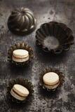 Caramel and chocolate macarons Stock Image