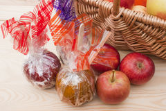 Caramel, chocolate, toffee and fresh red apples. Stock Photography