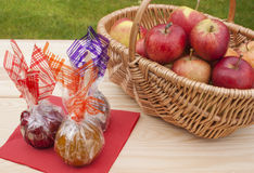 Caramel, chocolate, toffee and fresh red apples. Royalty Free Stock Images