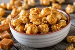 Caramel Coated Popcorn. A bowl of delicious homemade caramel coated popcorn royalty free stock photo