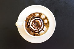Caramel coffee in white cup Stock Image