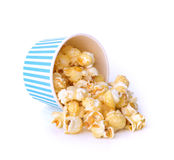 Caramel corn out of the paper cup on white background Stock Photos
