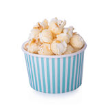 Caramel corn in paper cup on white Stock Photography