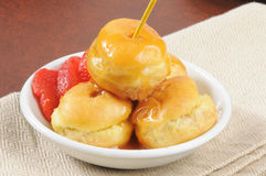 Caramel covered cream puffs Stock Photography