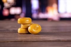Caramel cream candy butterscotch with restaurant. Group of four whole caramel cream candy butterscotch variety with restaurant in background royalty free stock images
