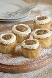 Caramel and cream muffins on wooden board Royalty Free Stock Photo