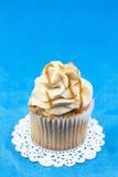 Caramel Cupcake On Blue Background Royalty Free Stock Photo