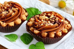 Caramel cupcake. Close up of toffee shortbread cupcakes with nuts Stock Photography