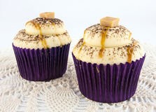 Caramel cupcakes in purple foil Royalty Free Stock Image