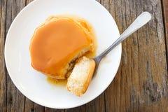 Caramel custard cake on white plate. Stock Photo