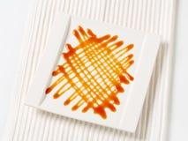 Caramel drizzle sauce decoration Stock Image