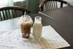 Caramel drizzled iced coffee with milk Stock Photography