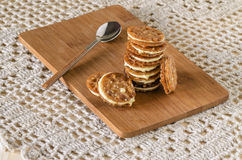 Caramel Florentines cookies on a wooden cutting board stock image