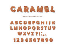 Caramel font design. Sweet glossy ABC letters and numbers. Royalty Free Stock Photography