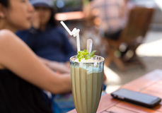 Caramel frappe coffee and mint leaf Stock Images