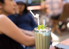 Caramel frappe coffee and mint leaf Royalty Free Stock Photography