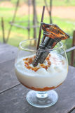 Caramel frappe coffee with syrup bottle at top Royalty Free Stock Image