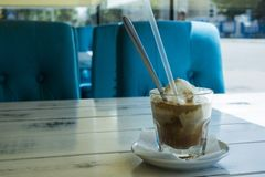 Caramel frappe cofftt in the cafe. Caramel frappe coffee in the cafe, Ice beverage in a tall glass with cream. with latte macchiato Royalty Free Stock Photos