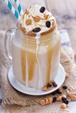 Caramel frappuccino with syrup Royalty Free Stock Images