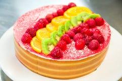 Caramel and fruits cake stock photos