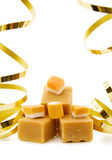 Caramel fudge with festive ribbons Stock Image