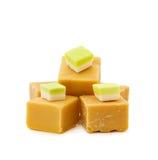 Caramel fudge and vanilla candy. Mix of sweets - caramel fudge and vanilla candy isolated on white Royalty Free Stock Photos