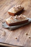 Caramel Hazelnut Financier with Crumble Topping. Traditional French cake, on wooden table stock photos
