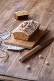 Caramel Hazelnut Financier with Crumble Topping. Traditional French cake, on wooden table royalty free stock image