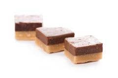Tasty caramel heap on white background Stock Image