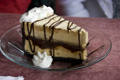 Caramel Ice Cream Pie. Luscious caramel and chocolate double layer ice cream pie with whipped cream topping Stock Photography